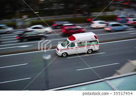 Ambulance running on the main road 35517454