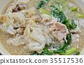 stir fried large noodle with pork in gravy sauce  35517536