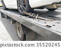 Car tire secured with safety belt on tow truck 35520245