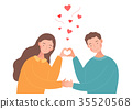 couple are making a heart shape with their hands. 35520568