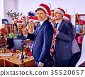 Christmas business cocktail party in office. 35520657