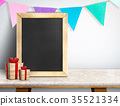 Blackboard with gift box and colorful flag banner 35521334