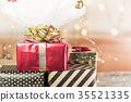 Red glossy present box with golden bow and ribbon 35521335