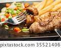 Pork rolls with french fries with vegetable 35521406
