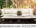 Wooden garden lounge chair with cushion in garden 35525264