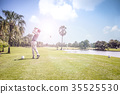 Man playing golf on a golf course 35525530