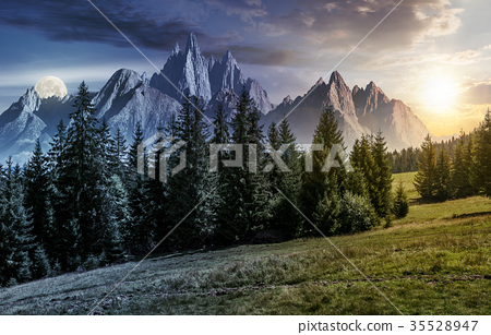 time change concept over forest and rocky peaks 35528947