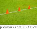 Orange cones on turf football. 35531129