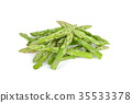 pile of fresh asparagus on white background 35533378