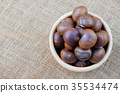 Chestnuts on sack. 35534474