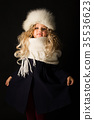 Pretty girl in winter clothes 35536623