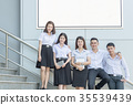 students stand and smile on stairs  35539439
