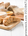 Homemade croissant on wood block, fresh bakery 35539471
