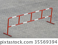 barrier standing on the grey stone block paving 35569394