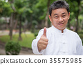 senior man showing thumb up hand gesture 35575985
