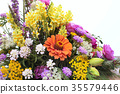 bouquet of different flowers on white background 35579446