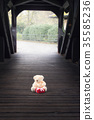 Stuffed toy and gift in a wooden tunnel 35585236