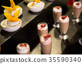 Variation of desserts in glasses 35590340
