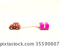 Red beetle car are dragging pink gift box  35590607