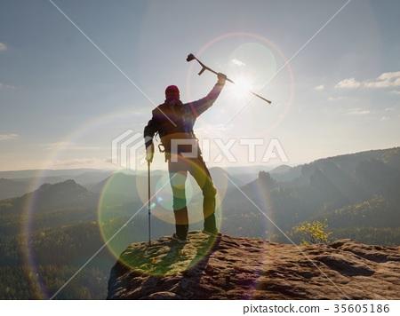 Difficult exam. Man walking againts the crutches 35605186