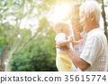 Grandfather, grandmother and grandson portrait. 35615774