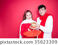 couple hold pig and envelope 35623309