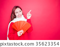 woman holding red envelope 35623354