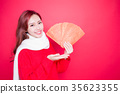 woman holding red envelope 35623355