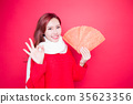 woman holding red envelope 35623356