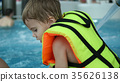 A boy swims in the pool. Relaxation and fun in the 35626138
