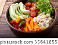 Vegan buddha bowl on wooden background. 35641855