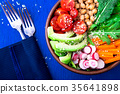 Vegan buddha bowl on blue wooden background 35641898