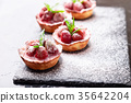 Homemade strawberries tarts with powdered 35642204