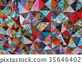 Brightly colored homemade patchwork with abstract 35646402
