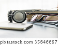 Headphones with book and mobile phone 35646697