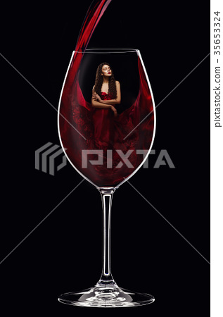 girl in red dress inside wine glass 35653324