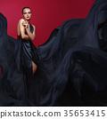 beautiful woman in flying silk dress 35653415