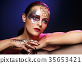 beautiful woman with bright makeup with glitter 35653421