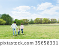 Parent and child playing in the park 35658331