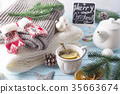 Hot green tea with lemon on a wooden table 35663674