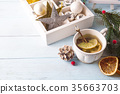 Hot green tea with lemon on a wooden table 35663703