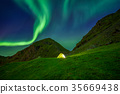 Illuminated tent in Norway with the northern 35669438