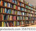 Library stacks of books and bookshelf. 35670333