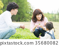 Parent and child playing in the park 35680082