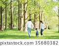 Parent and child playing in the park 35680382