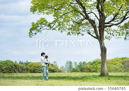 Parents and children (dad and daughter) playing in the park 35680785