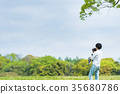 Parents and children (dad and daughter) playing in the park 35680786
