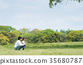 Parents and children (dad and daughter) playing in the park 35680787
