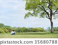 Parents and children (dad and daughter) playing in the park 35680788