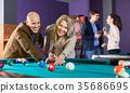 People playing billiard 35686695